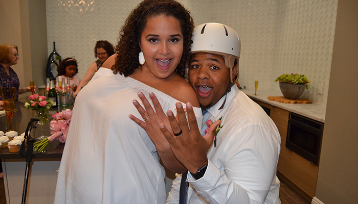 Sahmah Nakumbe and his wife, Taylor, celebrate their wedding day by showing off their rings.