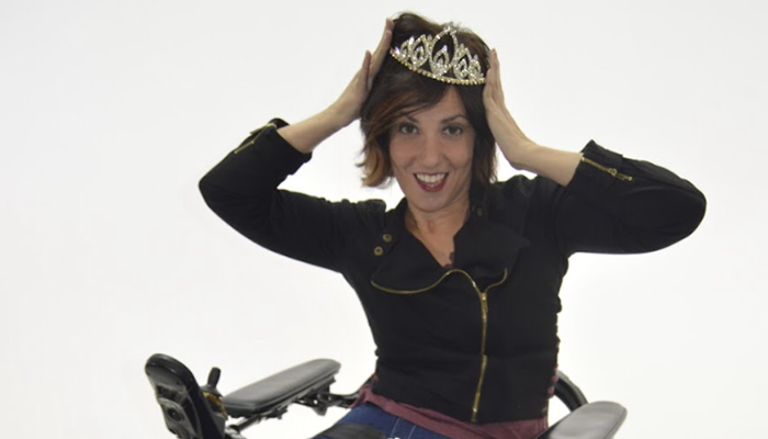 Heidi McKenzie poses with a crown she received when she was named Miss Wheelchair Kentucky USA.