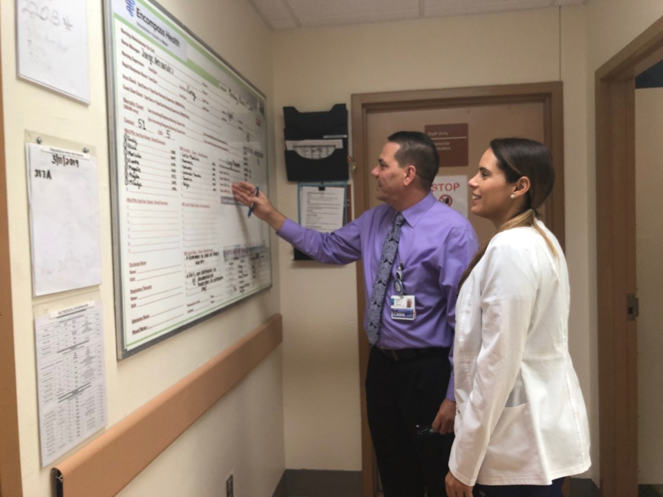 Encompass Health Miami CNO Rafael Alvares Luis with Nursing Supervisor Zuray Avila discussing their daily rounds.
