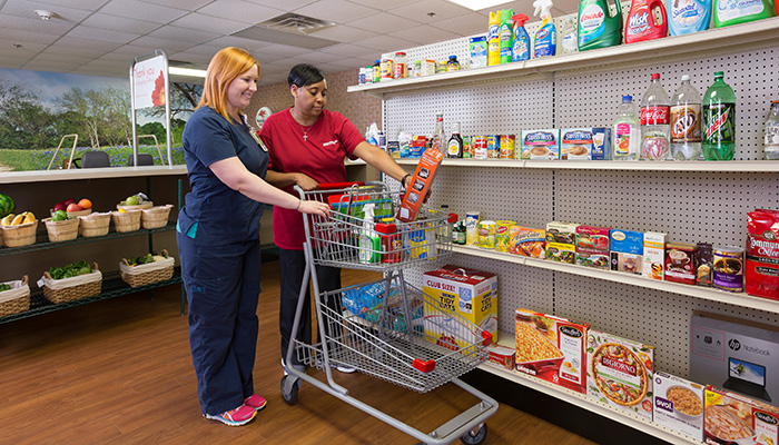 An Encompass Health therapist takes her patient through REAL Therapy's grocery shop module.