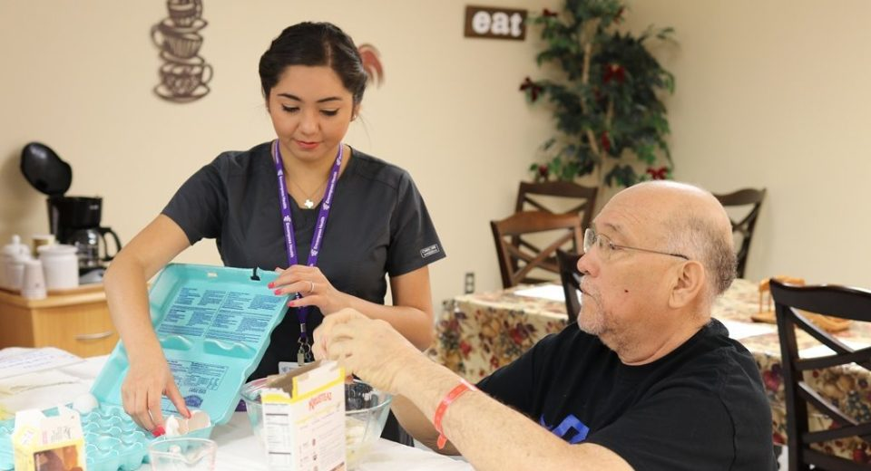 An Encompass Health OT helps a patient prepare a meal