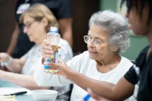 Female patient holding bottle of vegetable oil