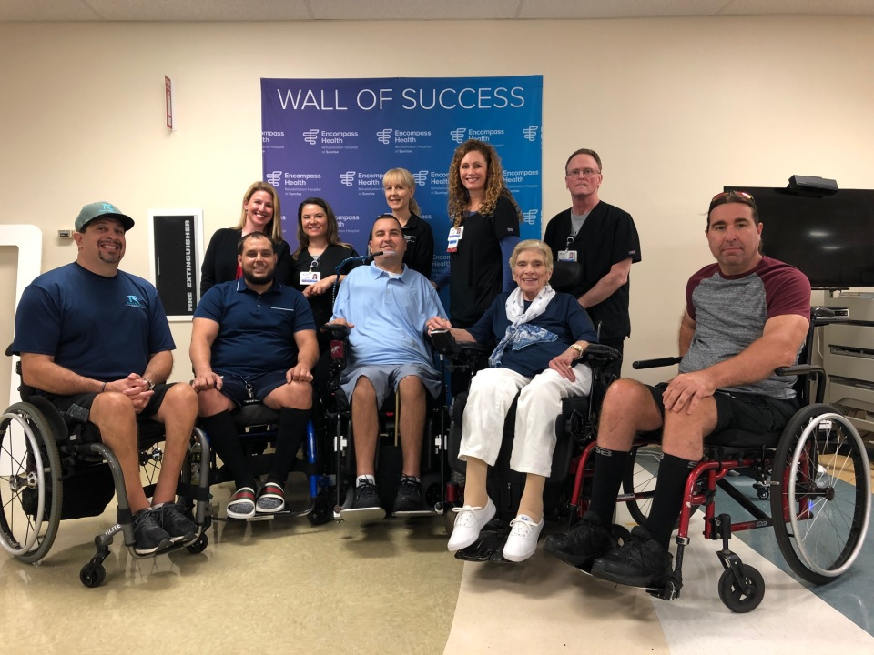 Members of the SCI Support Group of South Florida's Broward Chapter appear with Encompass Health Sunrise nursing and therapy staff.