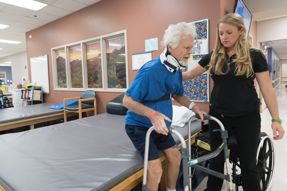 A patient receives physical therapy in an Encompass Health gym