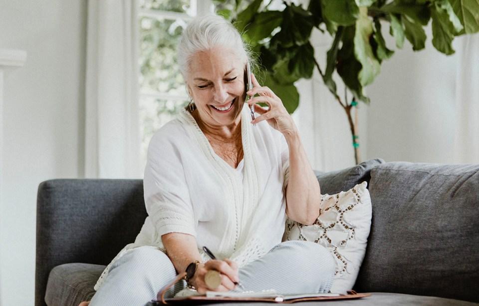 A senior citizen talking on the phone