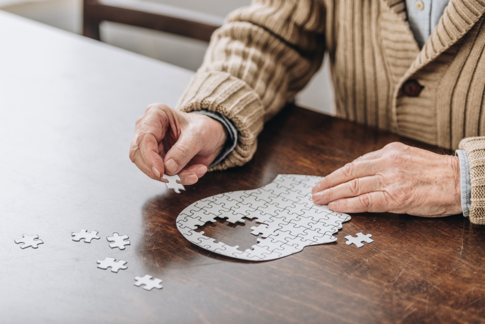 Senior man working on a puzzle