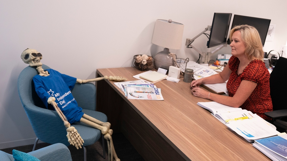 Dina Walker, Encompass Health national director of case management, said the skeleton in her office is her constant reminder that patients are always her first priority.