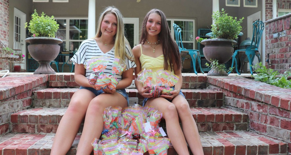 Encompass Health hospice volunteers with Easter gift bags they created for patients
