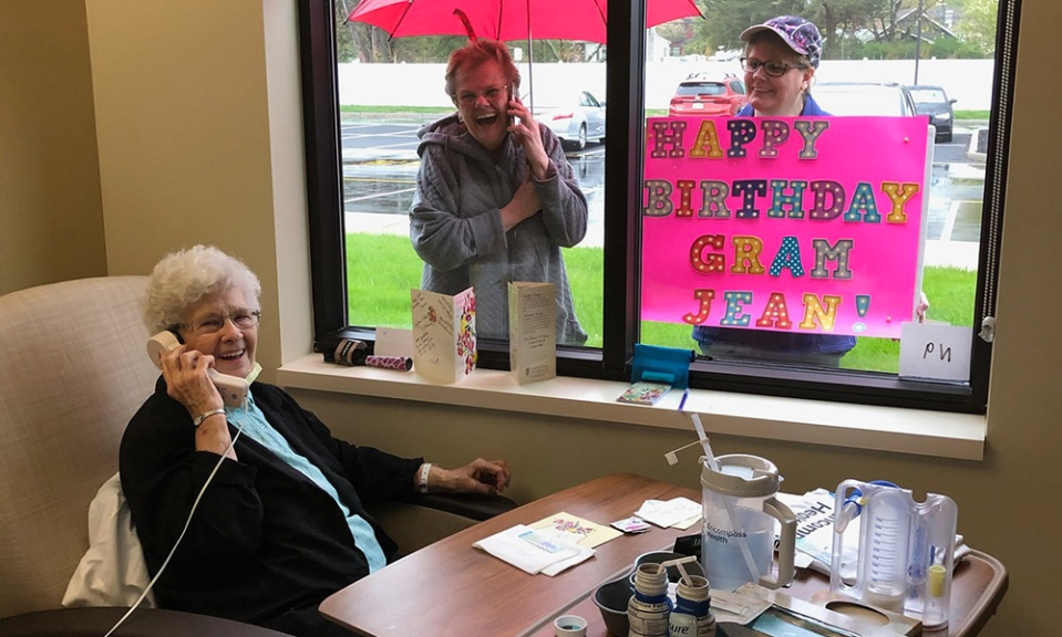 An Encompass Health patient recovering from COVID-19 celebrates her 91st birthday with family outside her window