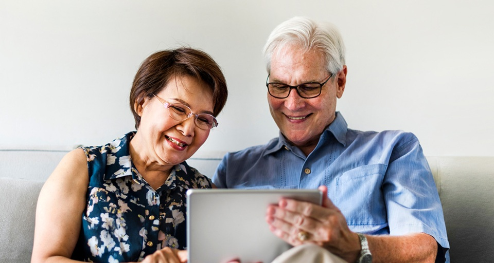 An older couple video chats with family
