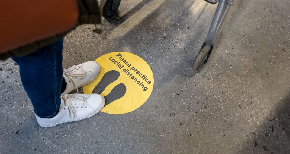 Social Distance Sign on the floor during COVID-19