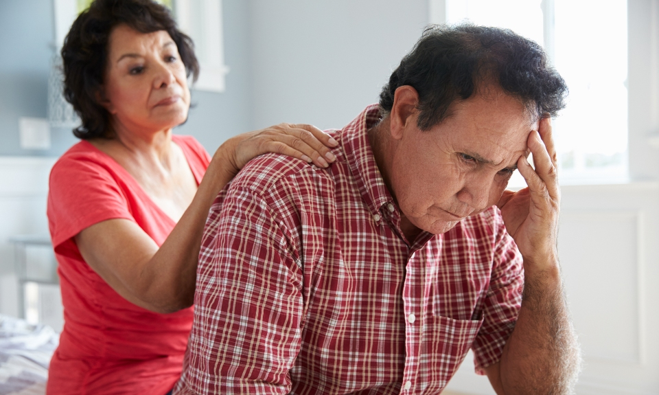 Wife Comforting Senior Husband Suffering With depression after a stroke
