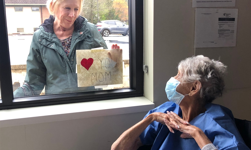 daughter visits mother outside her hospital room window