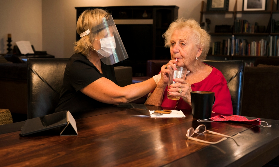 Speech therapist assess a patient's swallow function during a dysphagia therapy session