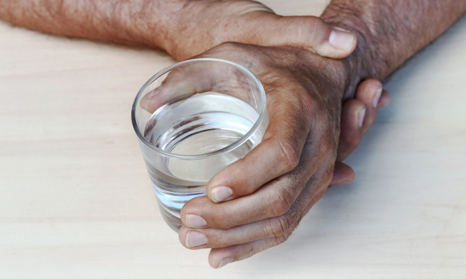 Man holds glass of water