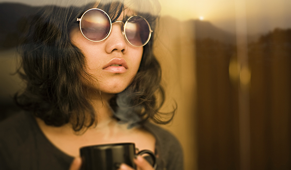 image of woman wearing sunglasses indoors