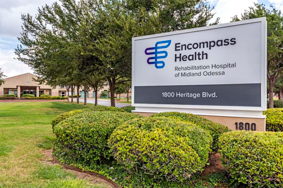 Hospital exterior sign that says Encompass Health Rehabilitation Hospital of Midland Odessa